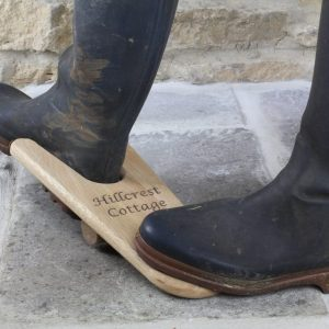 Personalised Oak Boot Jack in use