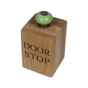Medium solid oak doorstop with green door knob