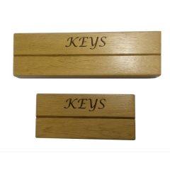 long and short oak key holder slot racks above plain