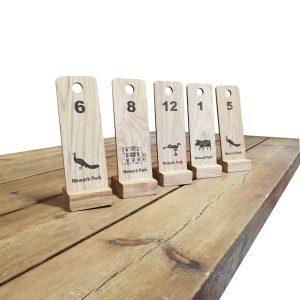 Newark Park oak table number displays on table
