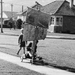Boys on a racing trolley